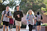 Students walking on Drill Field sidewalk next to Colvard Union.<br />  (photo by Megan Bean / &copy; Mississippi State University)
