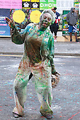 London, UK. 24 August 2014. The traditional J'ouvert or Jouvet parade on Children's Sunday at Notting Hill Carnival which traditionally takes place over the August Bank Holiday weekend. At the early mornign parade, participants cover each other with flour and paint.