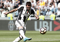 Calcio, Serie A: Juventus vs Crotone. Torino, Juventus Stadium, 21 maggio 2017.<br /> Juventus&rsquo; Mario Mandzukic kicks the ball during the Italian Serie A football match between Juventus and Crotone at Turin's Juventus Stadium, 21 May 2017. Juventus defeated Crotone 3-0 to win the sixth consecutive Scudetto.<br /> UPDATE IMAGES PRESS/Isabella Bonotto