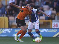 Blackburn Rovers' Derrick Williams is tackled by  Wolverhampton Wanderers' Romain Saiss<br /> <br /> Photographer Rachel Holborn/CameraSport<br /> <br /> The EFL Sky Bet Championship - Wolverhampton Wanderers v Blackburn Rovers - Saturday 22nd April 2017 - Molineux - Wolverhampton<br /> <br /> World Copyright &copy; 2017 CameraSport. All rights reserved. 43 Linden Ave. Countesthorpe. Leicester. England. LE8 5PG - Tel: +44 (0) 116 277 4147 - admin@camerasport.com - www.camerasport.com