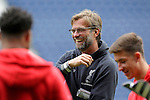Liverpool manager Jurgen Klopp jokes with junior players before the Barclays Premier League match at The Hawthorns.  Photo credit should read: Malcolm Couzens/Sportimage