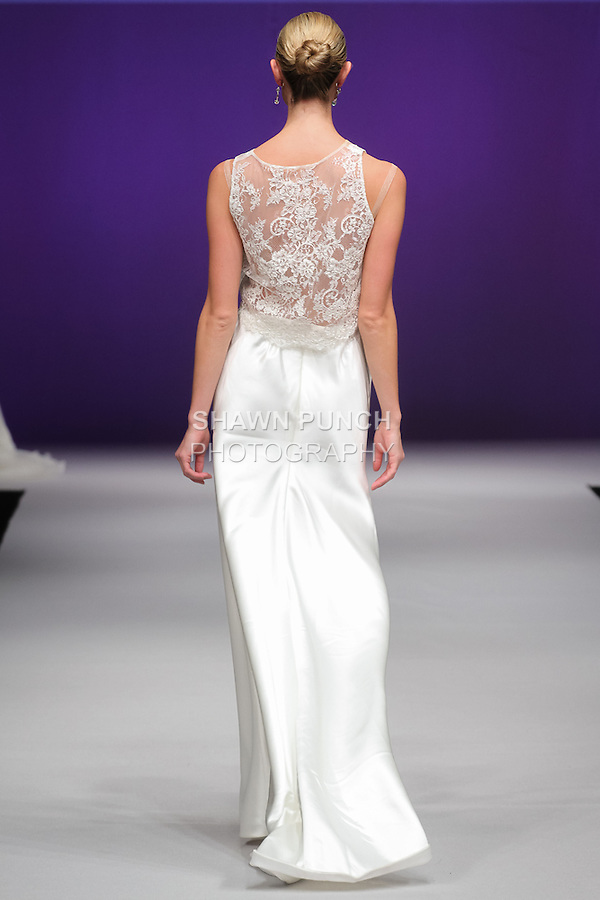 Model walks runway in a bridal gown from the Augusta Jones Bridal collection by Charlotte Leung and June Leung, in the Designer Spotlight Fashion Fashion Show at Pier 94, during New York International Bridal Week Spring 2016.
