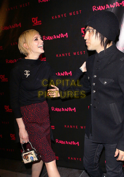 "ASHLEE SIMPSON & PETE WENTZ.Los Angeles Premiere of ""Runaway"" held at Harmony Gold Preview House, Los Angeles, California, USA..October 18th, 2010.half 3/4 length black jacket jeans denim boots top red maroon skirt chanel brooch smiling laughing side hat profile funny married husband wife short cropped hair .CAP/ADM/TC.©T. Conrad/AdMedia/Capital Pictures."