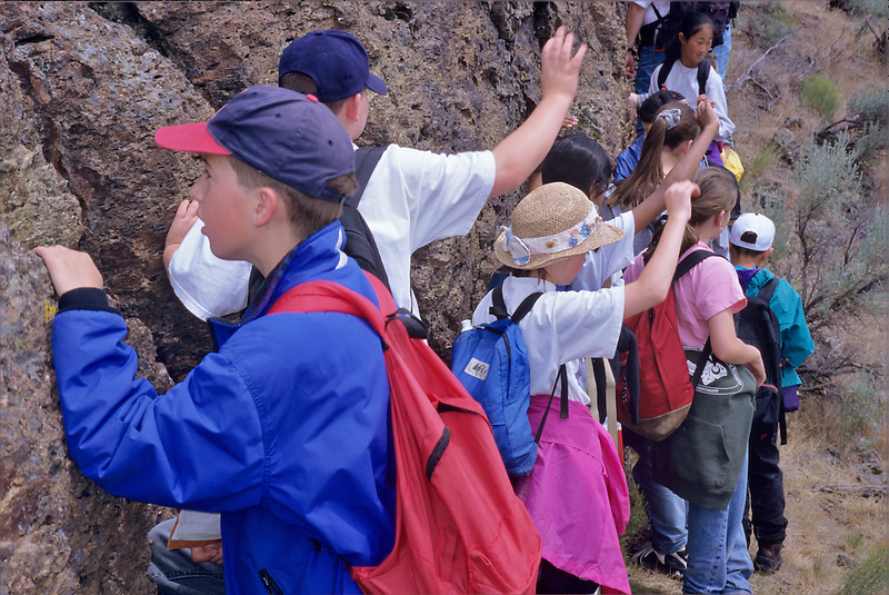 Students examing rock at Hancock Field Station, Oregon.