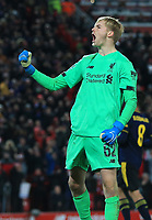 30th October 2019; Anfield, Liverpool, Merseyside, England; English Football League Cup, Carabao Cup, Liverpool versus Arsenal; Caoimhin Kelleher of Liverpool celebrates in front of the Kop after making his decisive penalty shootout save - Strictly Editorial Use Only. No use with unauthorized audio, video, data, fixture lists, club/league logos or 'live' services. Online in-match use limited to 120 images, no video emulation. No use in betting, games or single club/league/player publications