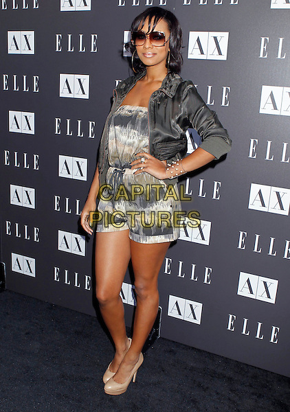 """KERI HILSON  .Armani Exchange and ELLE Present """"Disco Glam"""" With A Performance By Dragonette held at the A/X Robertson Store, Los Angeles, CA, USA..May 25th, 2010.full length grey gray jacket white pattern jumpsuit playsuit sunglasses shades beige shoes hand on hip.CAP/ADM/MJ.©Michael Jade/AdMedia/Capital Pictures."""