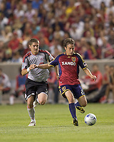 Real Salt Lake midfielder Ned Grabavoy (20) passes with Toronto FC midfielder Carl Robinson (33) in pursuit. Salt Lake Real defeated Toronto FC, 3-0, at Rio Tinto Stadium on June 27, 2009.