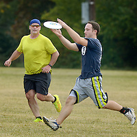 NWA Democrat-Gazette/BEN GOFF @NWABENGOFF<br /> John Pearson (right) of Bentonville makes a catch as Kendall Wilcox of Bentonville looks on on Monday Nov. 2, 2015 during the NWA Ultimate lunch hour game at Phillips Park in Bentonville.