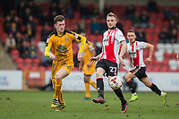 Paul Lewis of Cambridge United and Carl Winchester of Cheltenham Town during the Sky Bet League 2 match between Cheltenham Town and Cambridge United at the LCI Stadium, Cheltenham, England on 18 March 2017. Photo by Mark  Hawkins / PRiME Media Images.