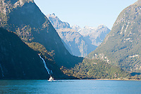 Milford Sound Cruise, Fiordland, South Island, New Zealand. Tourist boat on a boat trip at Milford Sound. Most cruises last a couple of hours and cost NZ$70-100. This is by far the best way to see Milford Sound.