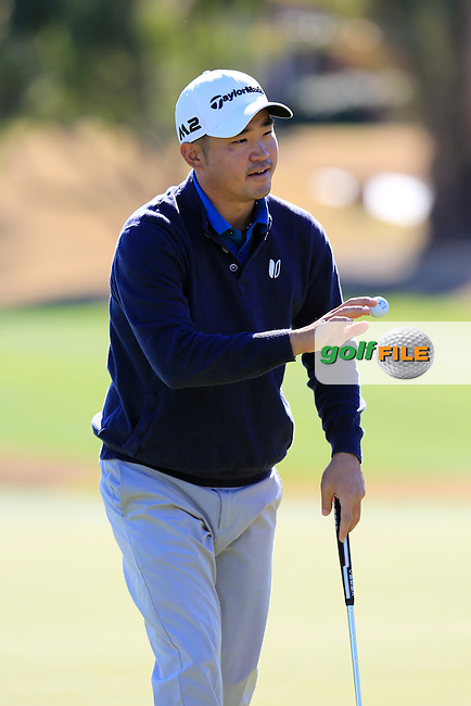 John Huh (USA) sinks his putt on the 18th green during Saturday's Round 3 of the 2017 CareerBuilder Challenge held at PGA West, La Quinta, Palm Springs, California, USA.<br /> 21st January 2017.<br /> Picture: Eoin Clarke | Golffile<br /> <br /> <br /> All photos usage must carry mandatory copyright credit (&copy; Golffile | Eoin Clarke)