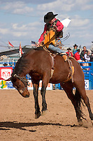 February, 2004 At the Tucson Rodeo, Bronco Riding competition in Tucson, Arizona.. .For Editorial use only / Permission from Pro Rodeo Cowboy's Association REQUIRED for any commercial usage..