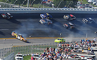 Apr 26, 2009; Talladega, AL, USA; NASCAR Sprint Cup Series driver Kyle Busch (18) spins while leading during the Aarons 499 at Talladega Superspeedway. Mandatory Credit: Mark J. Rebilas-
