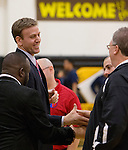 Reno coach Matt Ochs, left, shakes hands with Galena coach Brian Voyles before the start of the Northern Region Division I boys basketball game played at Galena High School on Tuesday night, Feb. 17, 2015.
