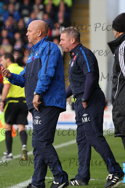 Kenny McDowall and Ally McCoist out giving instructions