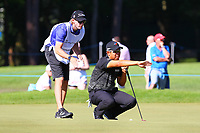 Byeong Hun An discusses his putt with his caddy on the #5 green during the BMW PGA Golf Championship at Wentworth Golf Course, Wentworth Drive, Virginia Water, England on 26 May 2017. Photo by Steve McCarthy/PRiME Media Images.