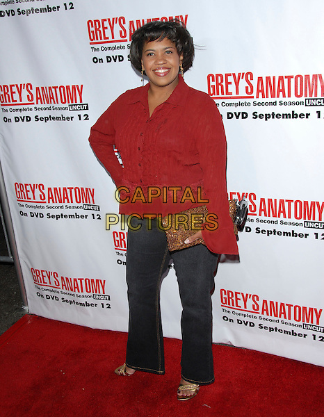 CHANDRA WILSON.The Grey's Anatomy 2nd Season DVD Launch held at Social in Hollywood, California, USA..September 5th, 2006.Ref: DVS.full length jeans denim red jacket top gold clutch purse.www.capitalpictures.com.sales@capitalpictures.com.©Debbie VanStory/Capital Pictures