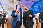 Facebook founder Mark Zuckerberg speaks with U2 lead singer and ONE Campaign cofounder Bono during a tour of the 'We The People' tent at the United Nations in New York Saturday, September 26, 2015. Zuckerberg and Bono joined some of the other biggest names in technology, global development and arts and entertainment in announcing they signed a Global Connectivity Declaration in response to the newly agreed UN Global Development Goals. Organized by the ONE Campaign, the Declaration calls on governments around the world to work together with innovators to finally deliver internet access to every person, everywhere. Among the first signers were also Bill and Melinda Gates from the Bill & Melinda Gates Foundation.<br /> Credit: Facebook via CNP