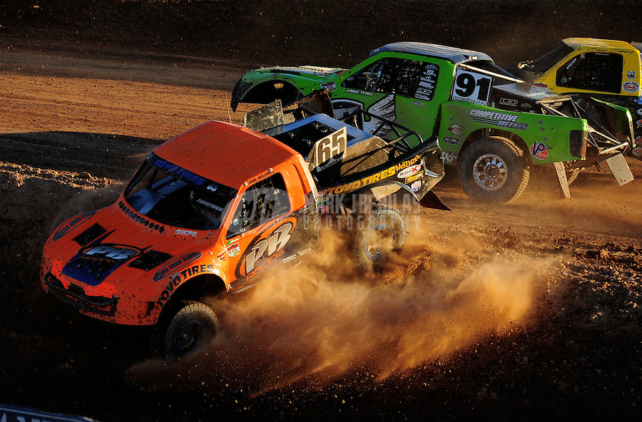 Dec. 10, 2011; Chandler, AZ, USA;  LOORRS pro two unlimited driver Phil Bollman (65) goes off track after contact with Nick Tyree (91) during round 15 at Firebird International Raceway. Mandatory Credit: Mark J. Rebilas-