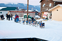 Sebastian Schnuelle runs through the streets at the Kaltag checkpoint on his way through during the 2010 Iditarod