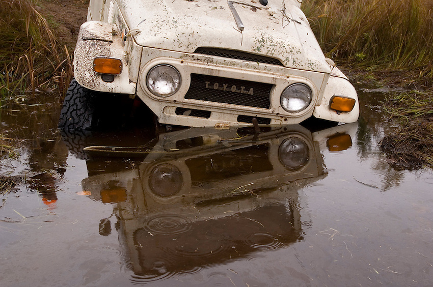 A Toyota Land Cruiser stuck in the mud of a beaver pond during a hunting trip near Gwinn Michigan.