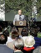 "United States President Gerald R. Ford holds a press conference in the Rose Garden at the White House in Washington, D.C. on October 9, 1974.  The President said he did not think the country was in a depression and that inflation would be reduced in 1975.  He also said his proposed 5% tax would not extend beyond 1975.  Ford is wearing a red button with the letters ""WIN"" on his lapel.  ""WIN"" stands for ""Whip Inflation Now"".<br /> Credit: Barry Soorenko - CNP"