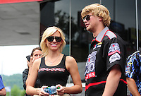 Jun. 17, 2012; Bristol, TN, USA: NHRA funny car driver Courtney Force (left) with Blake Alexander during the Thunder Valley Nationals at Bristol Dragway. Mandatory Credit: Mark J. Rebilas-