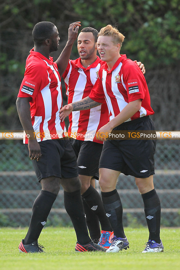 George Purcell (R) is congratulated by his team mates on scoring the second goal for AFC Hornchurch - AFC Hornchurch vs East Thurrock United - Ryman League Premier Division Football on Non-League Day at The Stadium, Upminster Bridge, Essex - 07/09/13 - MANDATORY CREDIT: Gavin Ellis/TGSPHOTO - Self billing applies where appropriate - 0845 094 6026 - contact@tgsphoto.co.uk - NO UNPAID USE