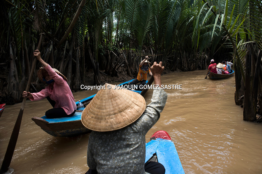Numerous boats sail through the Mekong Delta in the vicinity of Ho Chi Minh City (Vietnam)<br /> HO CHI MINH-VIETNAM