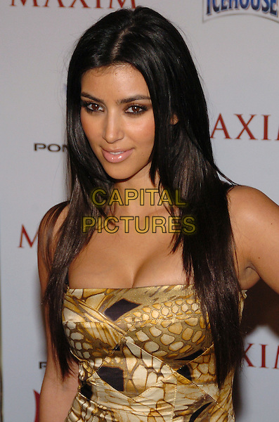 KIM KARDASHIAN.Maxim Magazine's 8th Annual Hot 100 Party at Gansevoort Hotel, New York City, New York, USA..May 16th, 2007.half length yellow brown beige pattern dress .CAP/ADM/BL.©Bill Lyons/AdMedia/Capital Pictures *** Local Caption ***