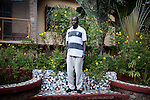 """INDIA, KERALA JUNE 2014:<br />Samuel Odwar, 33, a current student, wants to start a project to create support for parents of disabled children. His Gandhi moment came when he was 17, studying at a university in Gulu, northern Uganda, and kidnapped by members of the Lord's Resistance Army, a militant movement that claims to fight to create a theocratic state based on the Ten Commandments and Acholi tradition. They kept him for two weeks, training him to kill at sight. His first target, they demanded, would be a disabled woman. """"I refused to do it,"""" he said. """"So they threatened to kill me."""" He managed to escape in the chaos, walking days to reach home from a rebel camp near the Sudan border. """"Years later, as it turned out, God gave me a deaf child,"""" he said. """"I struggle with him a lot."""", June 2014  @Giulio Di Sturco"""