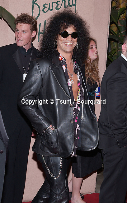 Slash arriving at the Clive Davis Pre-Grammy party at the Beverly Hills Hotel in Los Angeles. February 26, 2002.          -            Slash01.jpg