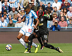 Collin Quaner of Huddersfield Town tackled by Mohamed Diame of Newcastle United during the premier league match at the John Smith's Stadium, Huddersfield. Picture date 20th August 2017. Picture credit should read: Simon Bellis/Sportimage