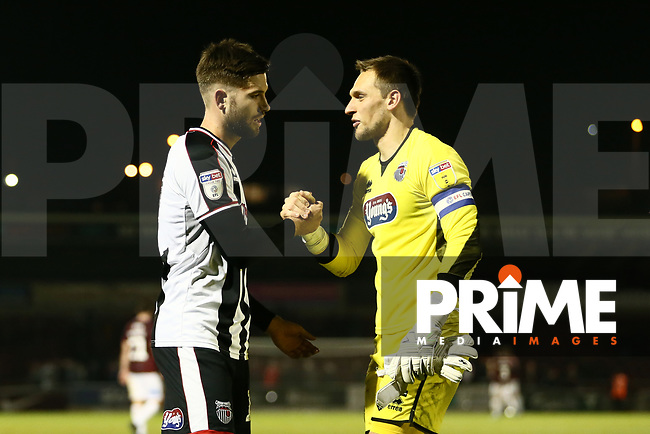 Harry Cardwell of Grimsby Town and James McKeown of Grimsby Town after the Sky Bet League 2 match between Northampton Town and Grimsby Town at Sixfields Stadium, Northampton, England on 24 November 2018. Photo by Leila Coker / PRiME Media Images.