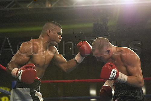 8 June 2004, Colombian junior welterweight Juan Urango throws punches at Sergey Sorokin during a Warriors Boxing Promotion at the new Seminole Hard Rock Casino in Hollywood, Fl.  Juan Urango won the fight Photo: Juerg Schreiter/Actionplus..boxer boxing 040608..