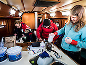 In the cabin of the ship Julie Lawson, executive director of Trash Free Maryland, preserves a water and soot sample taken from the Chesapeake Bay. The Sample will be sent to Florida Atlantic University for analysis. Joining Lawson on the expedition is Julie Hester of the Campbell Foundation and Johnathan Berard of the Blue Water Baltimore. <br /> PHOTOS/John Nelson