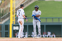 Surprise Saguaros right fielder Khalil Lee (15), of the Kansas City Royals organization, talks to Tyler Nevin (2) during an Arizona Fall League game against the Salt River Rafters at Salt River Fields at Talking Stick on October 23, 2018 in Scottsdale, Arizona. Salt River defeated Surprise 7-5 . (Zachary Lucy/Four Seam Images)