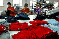 Indian women wokers finaly chcking the finished products  at Popy's garment stitching factory in Tirupur, Tamilnadu. After lifting of quota system in textile export on 1st january 2005. Tirupur has become the biggest foreign currency earning town of India.