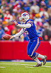 14 December 2014: Buffalo Bills punter Colton Schmidt kicks a 48-yarder in the first quarter against the Green Bay Packers at Ralph Wilson Stadium in Orchard Park, NY. The Bills defeated the Packers 21-13, snapping the Packers' 5-game winning streak and keeping the Bills' 2014 playoff hopes alive. Mandatory Credit: Ed Wolfstein Photo *** RAW (NEF) Image File Available ***