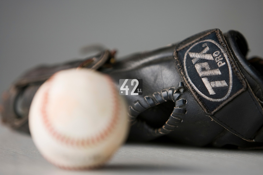 19 August 2007: A glove and a baseball lie in the dugout during the Japan 4-3 victory over France in the Good Luck Beijing International baseball tournament (olympic test event) at the Wukesong Baseball Field in Beijing, China.