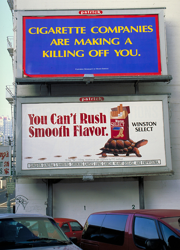 Billboards with competing messages. Cigarette advertisement and anti-smoking message. San Francisco California.