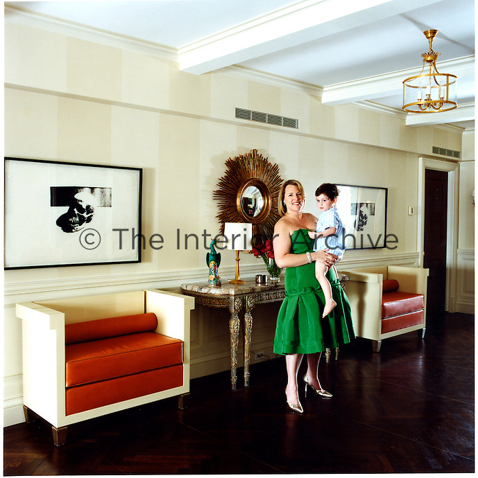 Marjorie Gubelmann and her son, Cyrus, in the entrance hall of her New York apartment