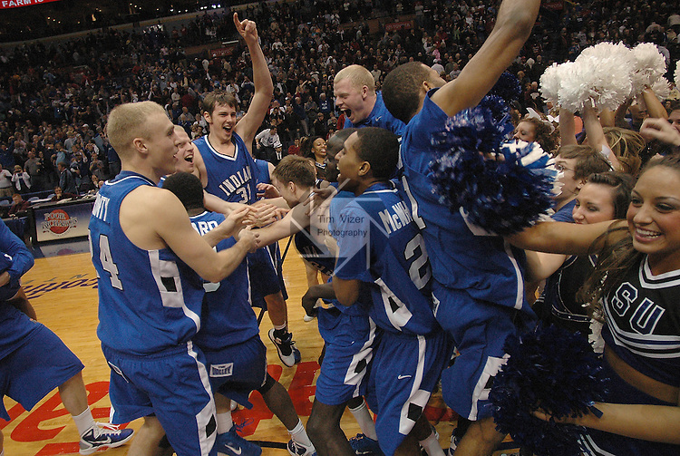 March 5,  2011         Indiana State players celebrate after they defeated MIssouri State 60-56 in the championship game of the NCAA Missouri Valley Conference Men's Basketball Tournament on Sunday March 6, 2011 at the Scottrade Center in downtown St. Louis.  They received an automatic bid to the NCAA Basketball Tournament