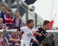 DC United midfielder Chris Pontius (13) and New England Revolution midfielder Stephen McCarthy (26) battle for head ball. In a Major League Soccer (MLS) match, DC United defeated the New England Revolution, 2-1, at Gillette Stadium on April 14, 2012.