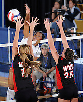 22 November 2008:  New Orleans outside hitter Lindsey Loyd (1) hits a kill shot during the WKU 3-0 victory over New Orleans in the championship game of the Sun Belt Conference tournament at U.S. Century Bank Arena in Miami, Florida.