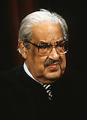 Associate Justice of the United States Supreme Court Thurgood Marshall poses for a photo during a photo-op at the U.S. Supreme Court in Washington, D.C. on Tuesday, September 11, 1990.  Marshall, the first African-American to serve as Associate Justice, was appointed in 1967 by U.S. President Lyndon B. Johnson..Credit: Robert Trippett / Pool via CNP