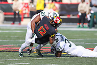 College Park, MD - November 3, 2018:  Maryland Terrapins wide receiver Taivon Jacobs (12) is tackled by several Michigan State Spartans defenders during the game between Michigan St. and Maryland at  Capital One Field at Maryland Stadium in College Park, MD.  (Photo by Elliott Brown/Media Images International)