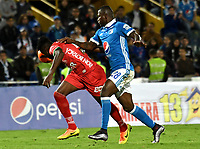 BOGOTA - COLOMBIA - 20 – 05 - 2017: Duvier Riascos (Der.) jugador de Millonarios disputa el balón con Oscar Cabezas (Izq.) jugador de Patriotas F.C., durante partido de la fecha 19 entre Millonarios y por la Liga Aguila I-2017, jugado en el estadio Nemesio Camacho El Campin de la ciudad de Bogota. / Duvier Riascos (R) player of Millonarios vies for the ball with Oscar Cabezas (L) player of Patriotas F.C., during a match of the date 19th between Millonarios and Patriotas F.C., for the Liga Aguila I-2017 played at the Nemesio Camacho El Campin Stadium in Bogota city, Photo: VizzorImage / Luis Ramirez / Staff.
