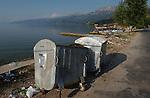 Tushemisht-Pogradec-Albania - August 02, 2004---Waste container at the shore of Lake Ohrid; region/village of project implementation by GTZ-Wiram-Albania (German Technical Cooperation, Deutsche Gesellschaft fuer Technische Zusammenarbeit (GTZ) GmbH); infrastructure-environment-pollution---Photo: Horst Wagner/eup-images