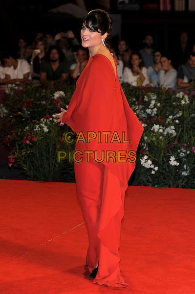 Selma Blair (wearing Lanvin).The 'Dark Horse' Premiere during the 68th Venice International Film Festival at Palazzo del Cinema, Venice, Italy. .September 5th, 2011.full length red dress side.CAP/PL.©Phil Loftus/Capital Pictures.